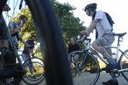 Friday Night Fixie Riders gather at the Campanile on the Kansas University campus. The rides commence at 6 p.m. the first, second and third Fridays of the month.