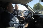 Police Chief Ramon Gonzalez Jr., left, likes the small-town feel of Perry, population 870, and how its residents watch out for one another. Gonzalez works part-time, as do his three officers.