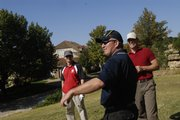 From left, Matthew Cuttell, Scott Clingan and Chris Smith, all soldiers in the Australian Army, laugh as another officer tees off Saturday at Alvamar Golf Course. Foreign military officers stationed at Fort Leavenworth were welcomed to Lawrence by James Schwartzburg of Packer Plastics. Officers from Australia, Korea, France, Germany, Great Britain, Japan, Czech Republic and the Philippines were present.