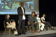 Athlete Alvin Harrison stands to speak about the lures of using performance-enhancing drugs and other obstacles in the way of keeping sports clean. Harisson spoke at the 2007 Anti-Doping Congress on Wednesday in Louisville, Ky. On stage with Harrison were athletes, from left, Tara Cunningham, Genai Kerr, Nathan Piasecki and Kelli White.