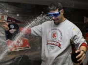 World Series MVP Mike Lowell gets sprayed with champagne after the Red Sox completed their sweep of the Rockies. Boston won Game 4, 4-3, Sunday  in Denver.