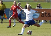 JKansas University's Monica Dolinsky puts her leg into a shot. The Jayhawks edged Iowa State, 1-0, Sunday at the Jayhawk Soccer Complex and clinched a berth in the Big 12 tournament.