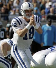 Indianapolis Colts quarterback Peyton Manning directs his team against the Carolina Panthers in this file photo from Sunday's game in Charlotte, N.C. Despite an undefeated record, the Colts are underdogs - at home, no less - Sunday when they play host to the Patriots.