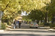 Pavement, like on the streets near Kansas University, is losing favor among runners.