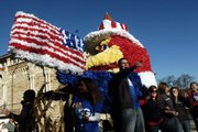 Float riders work to pump up the crowds gathered for the Kansas University homecoming parade on Saturday.