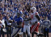 Kansas running back Brandon McAnderson cruises into the endzone past Nebraska defensive tackle Shukree Barfield in the first half Saturday, Nov. 3, 2007 at Memorial Stadium.