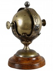 This rolling-ball hotel-lobby bell was used to call the desk clerk. The 6 1/2-inch-high bell was made about 1900 of nickel over brass. It sold for $575 at an online Morphy auction.