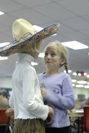 Seven-year-old Laura Heschmeyer, left, and Blythe Landon, right, talk while waiting in line for food Sunday, Nov. 4, 2007 at the 4-H Achievement Celebration at the Douglas County Fairgrounds. Heschmeyer and Blythe are part of the Eudora 4-H club. Heschmeyer participated in entomology and foods, and Landon participated in hand pets and foods.