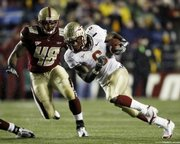 Florida State's Antone Smith (6) runs past Boston College's Tyronne Pruitt (48). The Seminoles toppled No. 2 BC, 27-17, on Saturday in Boston.