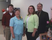 The Ashcrafts are the 2007 Douglas County 4-H Family of the Year, one of the highest honors that the county bestows. As a family, they have given at least 50 years to the county 4-H program. From left are Jim, Sue, Erin and Dick Ashcraft.