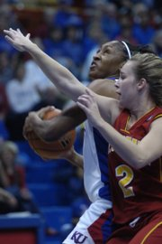 Kansas University forward Taylor McIntosh, left, drives past Pitt State senior guard Liz Witte. The Jayhawks opened their exhibition season with an 82-48 victory over the Gorillas on Sunday in Allen Fieldhouse.