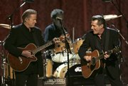Don Henley, left, and Glenn Frey of the Eagles perform during the 41st annual Country Music Association Awards in Nashville, Tenn. Wednesday's performance at the CMA Awards show was a first for the group.