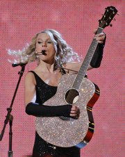 Taylor Swift, 17, who is a senior in high school, won the Horizon Award for newcomers in country music.