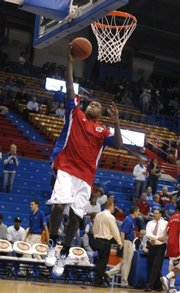 Kansas University's Rodrick Stewart warms up before the season opener against Louisiana-Monroe. Stewart likely will replace Sherron Collins in the starting lineup Thursday when KU plays host to Washburn.
