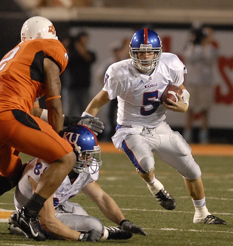 Kansas quarterback Todd Reesing looks to run during the first half Saturday, Nov. 10, 2007 at Boone Pickens Stadium in Stillwater.