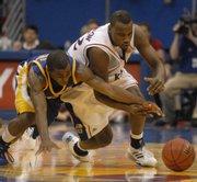 Kansas' Darnell Jackson and UMKC's Reggie Hamilton battle for a loose ball on Sunday, Nov. 11, 2007 in Allen Fieldhouse.