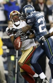 Seattle cornerback Marcus Trufant, right, levels San Francisco receiver Darrell Jackson, breaking up a pass. The Seahawks shut out the 49ers, 24-0, Monday in Seattle.