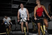 From left, Marsha Wilson, of Merriam, Christian Nafziger, of Westwood Hills, and Kristen Matthews, of Kansas City, Mo., pedal through a high-resistance phase of the workout.