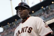Former San Francisco slugger Barry Bonds waits for his turn to bat in this file photo from Aug. 7. Bonds was indicted Thursday for perjury and obstruction of justice.