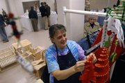 Suzanne Griffin, Topeka, attaches beads to a wind spinner Sunday, Nov. 18, 2007 in her booth at the Holiday Bazaar at the Community Building, 115 W. 11th St. She has been coming to the bazaar for three years.