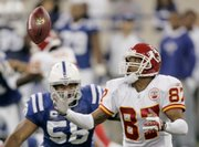 Kansas City Chiefs wide receiver Eddie Kennison (87) fumbles a punt while being tackled by Indianapolis Colts linebacker Gary Brackett. The Colts beat the Chiefs, 13-10, Sunday in Indianapolis.