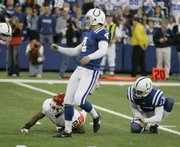 Indianapolis kicker Adam Vinatieri (4) watches his game-winning, 24-yard field goal. The kick lifted the Colts to a 13-10 victory over the Chiefs on Sunday in Indianapolis.