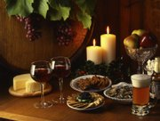 Background music and scents - candles or a pot of water with cinnamon simmering - can put guests in a festive mood.