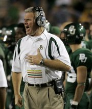 Guy Morriss shouts instructions to players in the first half of Baylor's 45-14 loss to Oklahoma State on Saturday in Waco, Texas. On Sunday, Morriss was fired as the Bears' coach.