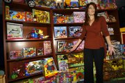 U.S. Consumer Product Safety Commission Director of Public Affairs Julie Vallese shows a display of recalled toys on Tuesday at CPSC Headquarters in Bethesda, Md.