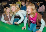 Kykee Wiggins, left, Brooke Stillian and Ryan Elvridge wait their turn at Basket Bounce, part of the 2006 Bromelsick Christmas Party for Scouts and 4-H participants. This year's event will be Dec. 2 at the Douglas County 4-H Fairgrounds Community Building.