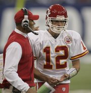 Kansas City coach Herm Edwards, left, talks with quarterback Brodie Croyle. The Chiefs' playcalling stayed conservative in the strong-armed Croyle's first NFL start, a 13-10 loss Sunday in Indianapolis.