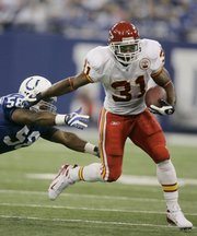 Kansas City running back Priest Holmes evades the tackle of Indianapolis linebacker Gary Brackett. FOXSports.com reported Tuesday that Holmes re-injured his neck and may be out for Sunday's game against Oakland - and perhaps much longer.