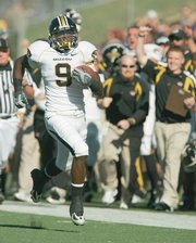 Missouri wide receiver Jeremy Maclin returns a kickoff 99 yards for a touchdown against Kansas State.