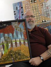 """Marty Olson is the featured artist for this year's Douglas County AIDS Project art auction. Olson holds his featured artwork, """"Closure,"""" which is on display at Wink Eyewear, 806 Mass., in advance of the art auction on Sunday."""