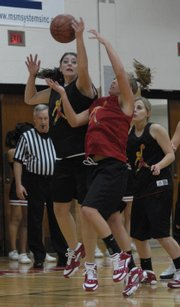 """Lawrence High basketball player Shelby Miller, left, rebounds the ball against Taylor Bird. Lawrence&squot;s varsity and junior varsity girls teams scrimmaged at """"Pack the House"""" on Monday at LHS."""