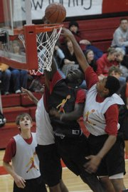 Basketball player Baba Diallo lays the ball up during a scrimmage.