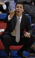 Florida Atlantic head coach Rex Walters - a former Kansas University standout player - instructs his offense in the first half.