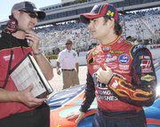 Jeff Meendering, left, talks with Jeff Gordon before the start of the 2007 Lennox 300. Meendering was named crew chief for Bobby Labonte's No. 43 Dodges.