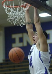 Haskell junior Ben Carrywater slams in this file photo from Nov. 30. Carrywater is averaging 19.4 points and 12.1 rebounds a game for the Fightin' Indians.