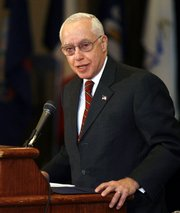 U.S. Attorney General Michael Mukasey on Thursday addresses the National Association of Attorneys General Annual Winter Meeting near Park City, Utah. Mukasey encouraged more states to add information to a database of mentally ill people.