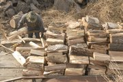 Don Cottrell stacks seasoned hardwood. The type of wood and its age can affect safety, woodcutters say.