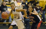 Haskell&#39;s Kortney Smith (23) drives baseline against Western State&#39;s Laura Franco. Haskell fell, 60-52, Tuesday at Coffin Complex.