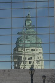 The dome of the Kansas Statehouse in downtown Topeka is reflected off the windows of a nearby building. Legislators have their hands full this year with lots of items on the agenda and little money to go around. And they'll be looking ahead to elections in November when all legislative seats will be on the ballot.