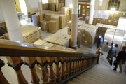 New furniture, waiting to be moved into renovated offices, sits stacked in boxes on the first floor of the north wing in the Topeka statehouse Tuesday, Dec. 4, 2007.