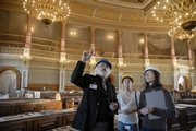 Kansas Statehouse architect Barry Greis, left, visits with architects Sarah Hammontree, center and Joy Coleman of Treanor Architects of Lawrence on Tuesday inside the House of Representatives chamber at the Capitol. The House chambers are currently being renovated, part of a 10-year Statehouse restoration project.