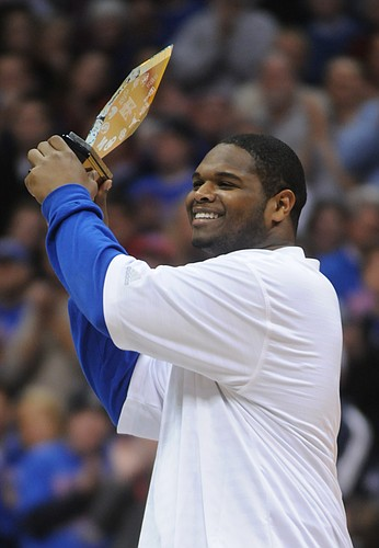 Kansas University defensive tackle James McClinton is honored by the Allen Fieldhouse crowd for his Big 12 defensive lineman of the year award.
