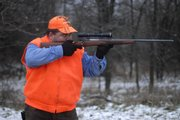 Charlie Garzillo scans a tree line through his scope Saturday, Dec. 8, 2007 while hunting near his property southwest of Lawrence near Pleasant Grove.
