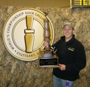 Jody Niccum, a 19-year-old sophomore at Baker University, poses with his World Duck Calling Championship trophy. He won the hardware over Thanksgiving weekend in Stuttgart, Ark.