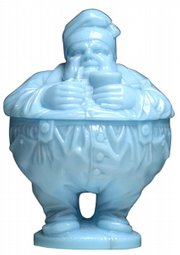 Charlot, a French comic-book character inspired by Charlie Chaplin, is the name of this blue glass sugar bowl. It is pictured in the 1933 Portieux catalog. Cowan's Auctions in Cincinnati sold it for $1,840 a few months ago.
