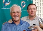 Former Miami Dolphins coach Don Shula, left, and quarterback Bob Griese laugh as they talk to reporters. They were among the '72 Dolphins taking part in a reunion Friday in Miami.